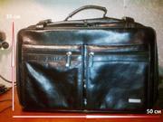 Сумка-чемодан дорожная,  черная,  натуральная кожа,  на колесиках.